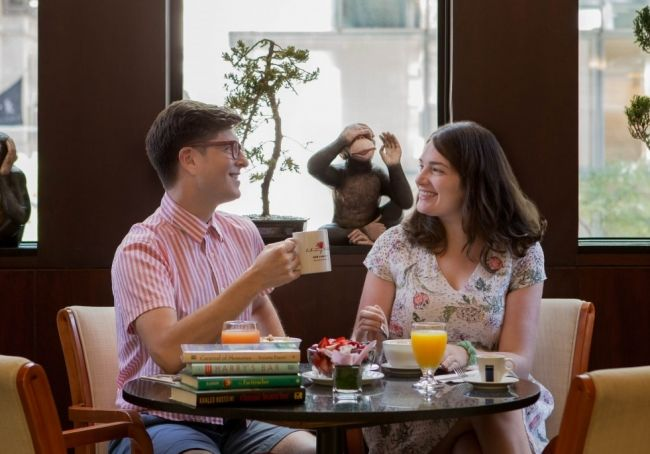 Couple enjoying breakfast at Library Hotel
