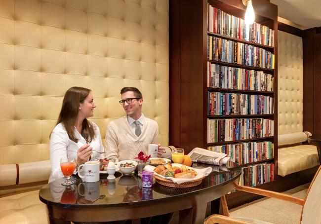 Couple enjoying breakfast in the Reading Room
