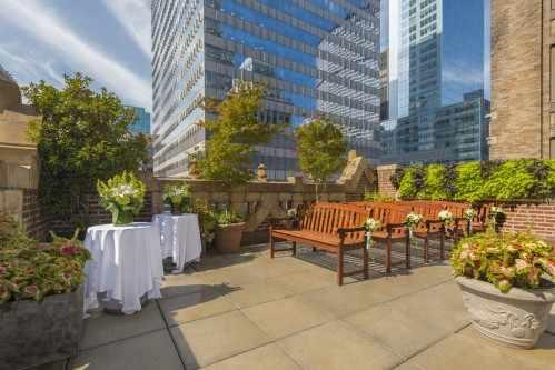 The beautiful wraparound outdoor terrace draws spectacular Manhattan views of the Public Library and surrounding New York architecture.