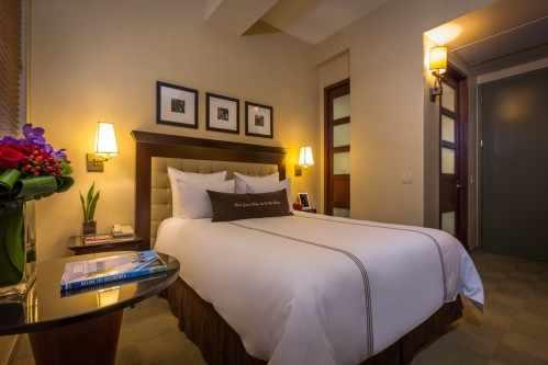 The Library Hotel's Deluxe Rooms are 250 square feet with one Queen Size Bed.