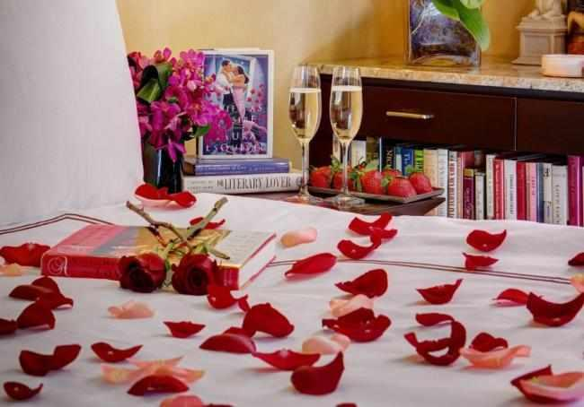 Rose petals laid out on the bed
