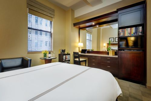 Deluxe Rooms offer more space, a large desk, and a spacious closet perfect for a long stay or a couple looking for comfort.