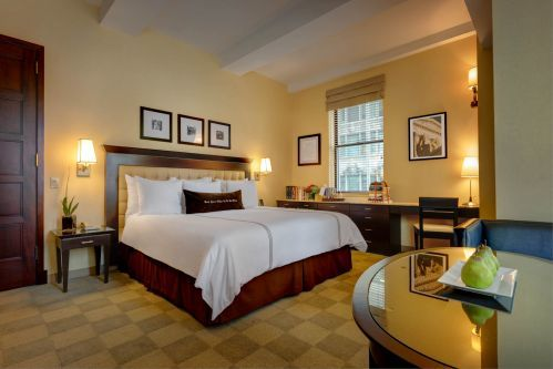 Spacious Junior Suite features 1 King Bed and 1 Sofa Bed with gorgeous views of Madison Avenue and the New York Public Library.