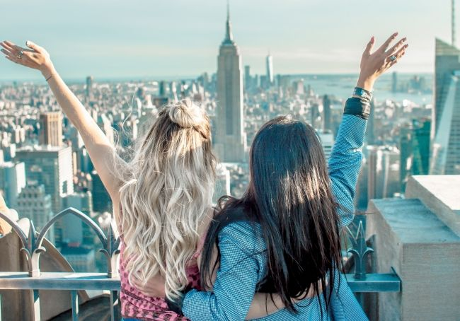 Girls enjoying Empire State Building